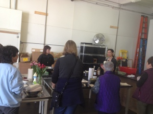 Kasie started the class with a review of the different meals we're preparing at each station.